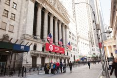 New York Stock Exchange. NEW YORK, NEW YORK - April 5, 2018: Tourists stand in front of the New York Stock Exchange on a Spring morning royalty free stock image