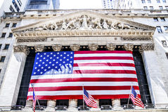New York Stock Exchange building in New York City. NEW YORK, April 29: An American flag hangs on the front of the New York Stock Exchange building in New York Royalty Free Stock Photos