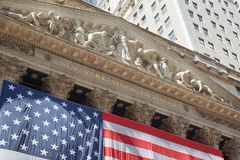 New York Stock Exchange building sign with big US flag Stock Image