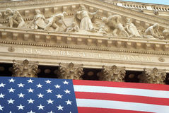 New York Stock Exchange exterior with American flag Royalty Free Stock Image