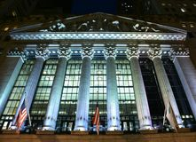 New York Stock Exchange Lit Up at Night Royalty Free Stock Images