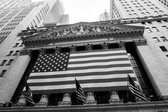 New York Stock Exchange. New York, NY: August 27, 2016: Flag draped NYSE on Wall Street. The New York Stock Exchange NYSE is the largest stock exchange in the Royalty Free Stock Photos