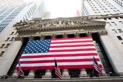 New York Stock Exchange. New York, NY: August 27, 2016: Flag draped NYSE on Wall Street. The New York Stock Exchange NYSE is the largest stock exchange in the Royalty Free Stock Photography