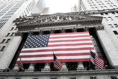 New York Stock Exchange. New York, NY: August 27, 2016: Flag draped NYSE on Wall Street. The New York Stock Exchange NYSE is the largest stock exchange in the Royalty Free Stock Photo