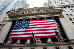 New York Stock Exchange. New York, NY: August 27, 2016: Flag draped NYSE on Wall Street. The New York Stock Exchange NYSE is the largest stock exchange in the Stock Photo