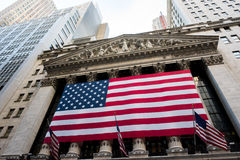 New York Stock Exchange. New York, NY: August 27, 2016: Flag draped NYSE on Wall Street. The New York Stock Exchange NYSE is the largest stock exchange in the Royalty Free Stock Images