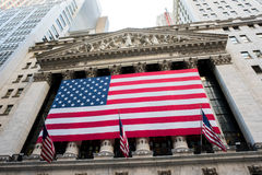 New York Stock Exchange. New York, NY: August 27, 2016: Flag draped NYSE on Wall Street. The New York Stock Exchange NYSE is the largest stock exchange in the Royalty Free Stock Image