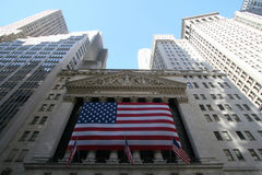 New York - the stock exchange in wall street. With giant USA flag royalty free stock images