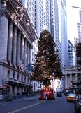 Stock Exchange at Christmas, New York. New York Stock Exchange in Wall Street with a Christmas Tree in the road., New York, USA stock photo