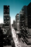 New York Street. And Skyline at dawn finished in mono with blue sky Royalty Free Stock Photography