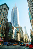 New York street with Empire State building Stock Photos