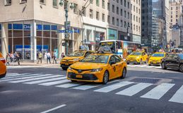New York, streets. High buildings, cars and cabs. USA, New York, Manhattan streets. May 2, 2019. Skyscrapers, signs and ads, cars and taxi cabs royalty free stock image