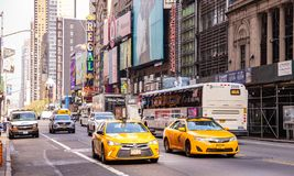 New York, streets. High buildings, colorful neon lights, cars and cabs. USA, New York, Manhattan streets. May 2, 2019. Skyscrapers, colorful neon signs and ads royalty free stock photography