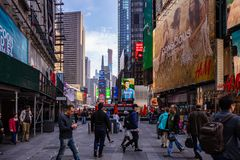 New York, streets. High buildings, colorful neon lights, and people. USA, New York, Manhattan streets. May 2, 2019. Skyscrapers, colorful neon signs and ads and stock photos