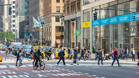 New York, streets. High buildings and people walking. USA, New York, Manhattan streets. May 2, 2019. Skyscrapers, cars and people crossing the street stock photography