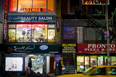 New York streets: illuminated shop and office Stock Photography