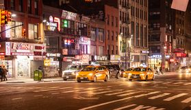 New York, streets at night. Illuminated buildings, colorful neon lights, cars and people walking. USA, New York, Manhattan. May 2, 2019. Streets at night royalty free stock photo