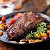 New york strip steak on iron skillet Stock Photos