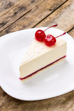 New York style cheesecake with pair of dessert cherries Royalty Free Stock Photography