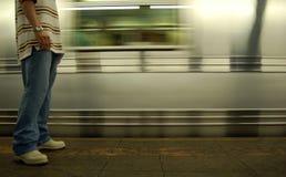 New York Subway. A man waiting on the platform when subway train arrives Royalty Free Stock Photos