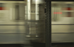 New York Subway. A New York Subway train passing the station at 103st street Stock Photo