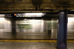 New York Subway. Subway train rushes past seventh avenue station in Manhattan, New York
