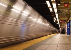 New York subway. With fast moving train and blurred unrecognizable people Royalty Free Stock Images