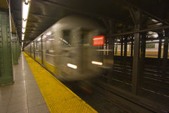 New York subway motion blur. New York subway speeding by a platform with motion blur Stock Photo