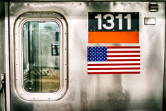 New York Subway train with american flag Royalty Free Stock Photography