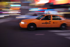 New York taxi driving through Times Square Royalty Free Stock Photo
