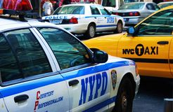 New York taxi and NYPD police cars Stock Images
