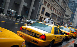 New York Taxis. Taxis lined up in Manhattan waiting for passengers on a rainy day Stock Photography