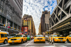 The New York Times building and characteristic Yellow Taxi Cab,o Stock Photography