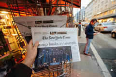 The New York Times Donald Trump new USA president. PARIS, FRANCE - NOV 10, 2016: Man buying The New York Times newspaper with shocking headline title at press royalty free stock image
