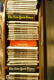 New York Times Newspapers. A stack of New York Times newspapers for sale at Penn Station, in Manhattan stock photo
