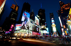 New York Times Square. With people walking and building with neon signs late in the evening in New York City on June 20 Stock Photography