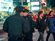 NEW YORK TIMES SQUARE, APR,24, 2015: Most beautiful New York Times Square police officer woman among tourists and people. NYC NYPD royalty free stock photo