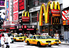 New York - Times Square Mc Donalds and cabs. Mc Donalds at Times Square, New York, with yellow cabs in front of it. Multitude of advertisements and lots of stock photography