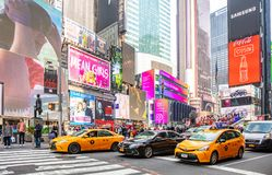 New York, Times Square. Scyscrapers, colorful neon lights, ads, cars and people. USA, New York, Times Square. May 2, 2019. High modern buildings, colorful neon royalty free stock photos