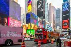 New York, Times Square. Scyscrapers, colorful neon lights, ads, cars and people. USA, New York, Times Square. May 2, 2019. High modern buildings, colorful neon stock photo