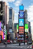 New York, Times Square. Scyscrapers, colorful neon lights, ads, cars and people. USA, New York, Times Square. May 3, 2019. High modern buildings, colorful neon stock photography