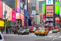 New York, Times Square. Scyscrapers, colorful neon lights, ads, cars and people. USA, New York, Times Square. May 3, 2019. High modern buildings, colorful neon royalty free stock photography