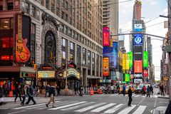 New York, Times Square. Scyscrapers, colorful neon lights, ads, cars and people. USA, New York, Times Square. May 3, 2019. High modern buildings, colorful neon stock image
