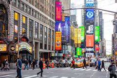 New York, Times Square. Scyscrapers, colorful neon lights, ads, cars and people. USA, New York, Times Square. May 3, 2019. High modern buildings, colorful neon royalty free stock image