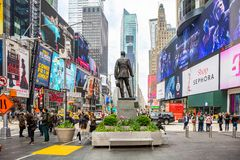 New York, Times Square. Scyscrapers, colorful neon lights, ads and George Cohan statue. USA, New York, Times Square. May 2, 2019. High modern buildings, colorful royalty free stock image