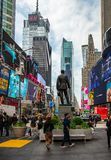 New York, Times Square. Scyscrapers, colorful neon lights, ads and George Cohan statue. USA, New York, Times Square. May 2, 2019. High modern buildings, colorful royalty free stock photos