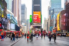 New York, Times Square. Scyscrapers, colorful neon lights, ads and people. USA, New York, Times Square. May 2, 2019. High modern buildings, colorful neon lights stock image