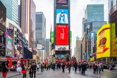 New York, Times Square. Scyscrapers, colorful neon lights, ads and people. USA, New York, Times Square. May 2, 2019. High modern buildings, colorful neon lights stock images