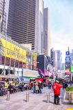 New York, Times Square. Scyscrapers, colorful neon lights, ads and people. USA, New York, Times Square. May 2, 2019. High modern buildings, colorful neon lights royalty free stock image