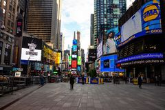 New York, Times Square. Scyscrapers, colorful neon lights, ads, and tv show. USA, New York, Times Square. May 3, 2019. High modern buildings, colorful neon stock photography
